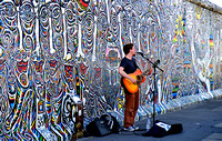 Busker at the Wall.